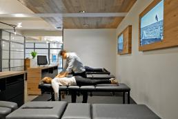Vitality Health & Wellness Chiropractic - Principal Chiropractor Serving a Patient